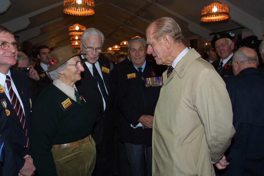 HRH chatting with a Land Army Girl veteran