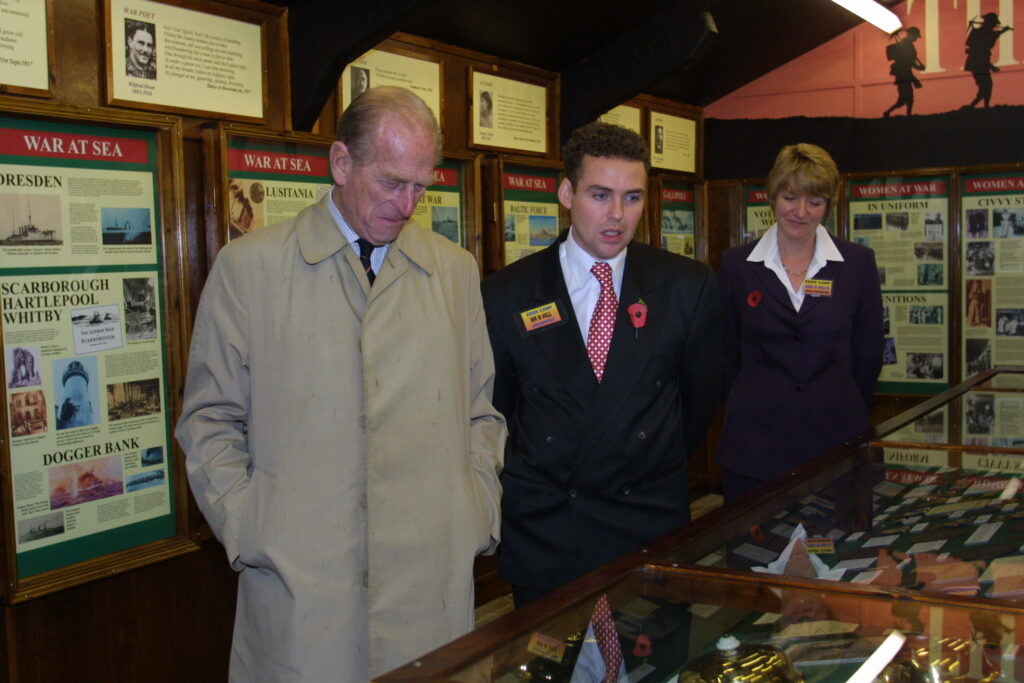 HRH with Nick Hill, Museum Manager - viewing World War One Exhibition